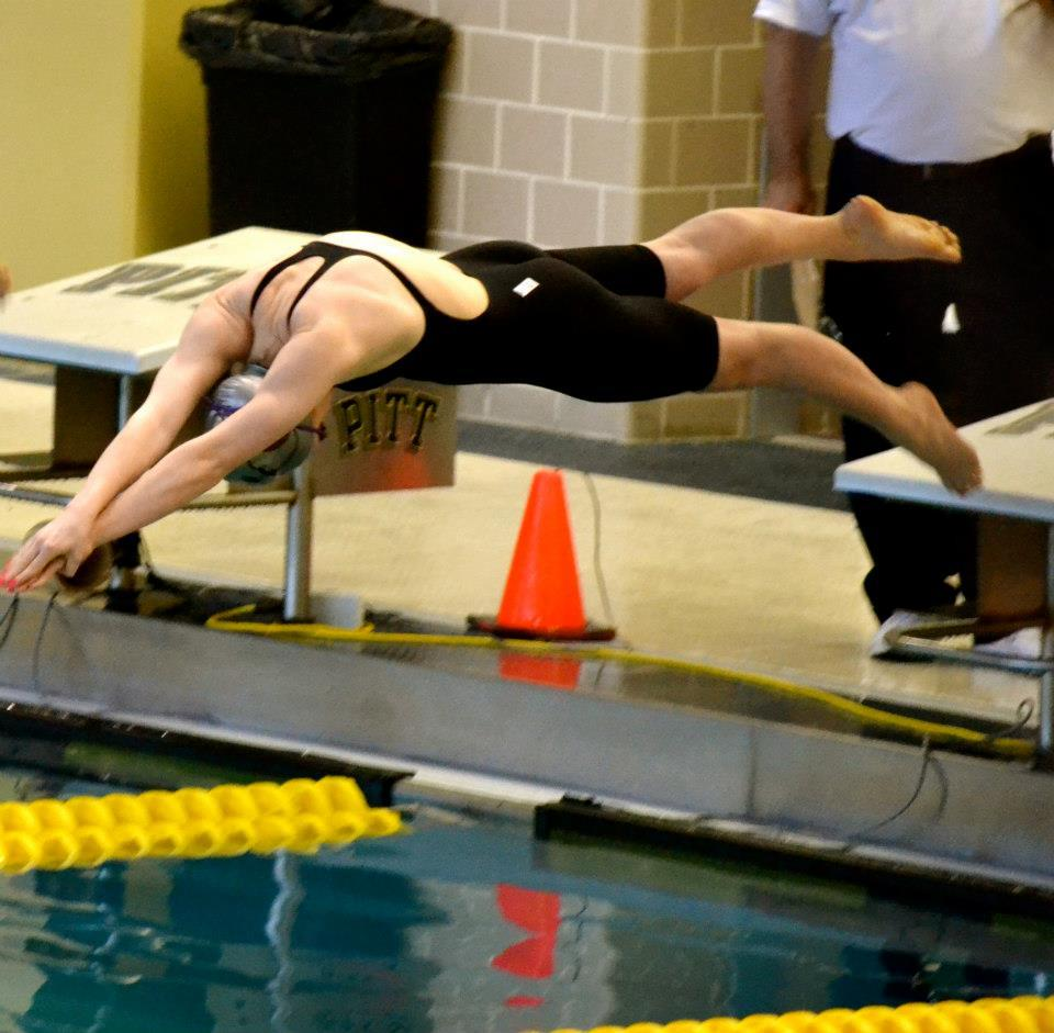 Junior, Natalie Feola, diving off of the blocks for the 50 Yard Freestyle